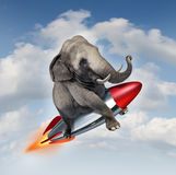 Courage And Determination. As a potential and possibilities concept with a realistic elephant flying in the air using a rocket as a business symbol of Stock Photos