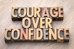 Courage over confidence word abstract in wood type. Courage over confidence word abstract in vintage letterpress wood type Stock Photo