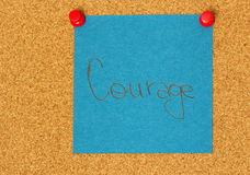 Courage post-it on a coarkboard background Royalty Free Stock Images