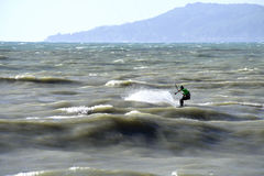 The courage to conquer the waves. Sochi, Russia, on 28 April 2016. The man is engaged in kitesurfing in the sea Royalty Free Stock Photography