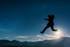 Courageous act in the mountains.Crazy mountaineer. Courageous act in the mountains Stock Images