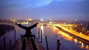 Courageous athlete making headstand on edge of bridge, adrenaline and sports. Stock photo royalty free stock photos