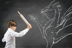 Courageous child. Concept of courageous child with drawing of dragon Stock Photography