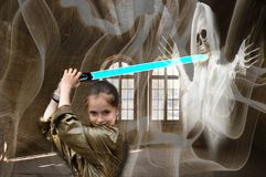Courageous girl as ghost hunter in a haunted mansion royalty free stock photos