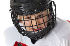 Only courageous play hockey. A young courageous hockey player with helmets look at the camera, isolated on white Stock Photography