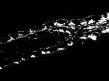 Courant d'eau sur un fond noir Photo libre de droits