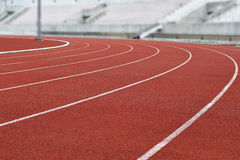 Courbe courante de voie de stade d'athlétisme Photographie stock
