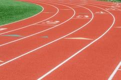 Courbe sur une voie courante d'athlétisme Photographie stock