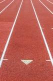 Courbe sur une voie courante d'athlétisme Photo libre de droits