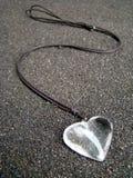Courbes de coeur de collier Images libres de droits
