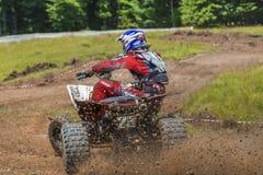 Coureur d'ATV dans la boue Photographie stock libre de droits