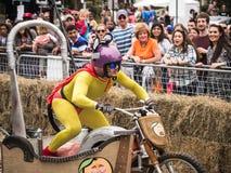 Coureur de tricycle de Red Bull Image stock