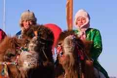 Coureurs de chameau de Naadam Photographie stock