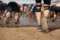 Coureurs de course de boue Photos stock