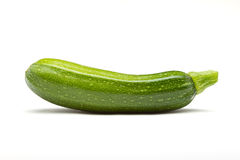 Courgette. Single Courgette or zucchini from low perspective isolated on white stock photos