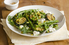 Courgette and asparagus salad. Asparagus and courgette salad with feta and sesame seeds Royalty Free Stock Photography