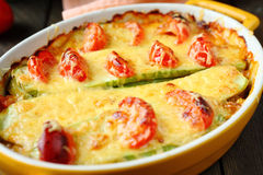 Courgette baked with cheese and tomatoes Royalty Free Stock Images