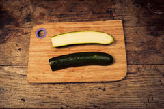 Courgette on chopping board Stock Photography