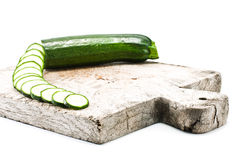 Courgette cut to slices on breadboard Stock Photography