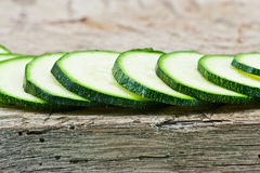 Courgette cut to slices on breadboard Royalty Free Stock Photos