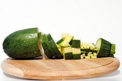 Courgette diced in different ways on wooden board Stock Images