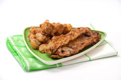 Courgette et champignons frits sur une nappe de plat et de cuisine Image libre de droits
