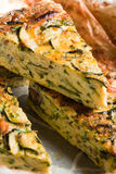 Courgette frittata. Slices of courgette frittata, close up stock photos