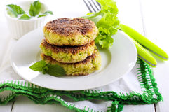 Courgette and herb cakes Stock Photo