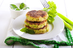 Courgette and herb cakes Stock Images