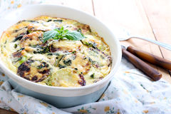 Courgette and herb gratin Stock Images