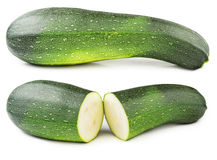 Courgette isolated. Fresh courgette cut in half isolated on white background stock photos
