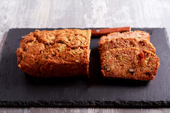Courgette loaf with sultana and nuts. Sliced on board royalty free stock photography