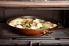 Courgette and ricotta cheese omlet in grill Royalty Free Stock Photography