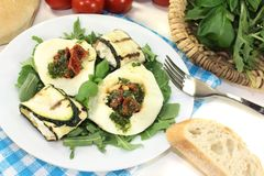 Courgette rolls and filled mozzarella with arugula Stock Image