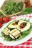 Courgette rolls and stuffed mozzarella. Courgette rolls and filled mozzarella and rocket salad on a bed royalty free stock photo