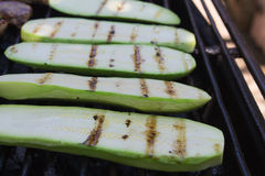 Courgette slices on the grill. A few courgette slices cooking on the grill Stock Images