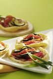 Courgette, tomato and bacon pastries Royalty Free Stock Image