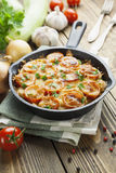 Courgettes baked with tomato and cheese Royalty Free Stock Photos