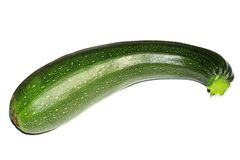Courgettes are closely related to the cucumber and the zucchini or courgettes can be eaten with peel Royalty Free Stock Image