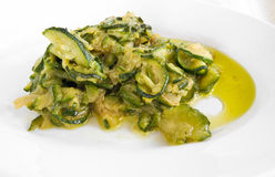 Courgettes cooked with olive oil and onions. Royalty Free Stock Photography