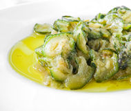 Courgettes cooked with olive oil and onions. Stock Photos