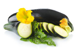 Courgettes cut into slices with flower and leaf on white Stock Photography