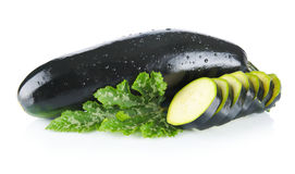 Courgettes cut into slices and leaves on white Royalty Free Stock Images