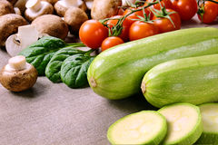Courgettes with mushrooms and tomatoes. Stock Photo