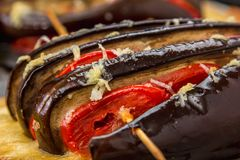 Courgettes stuffed with cheese, tomatoes, bell pepper Stock Image