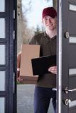 Courier with a box Royalty Free Stock Photo