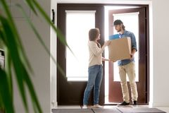 Courier bring an order to the customer woman stock photos