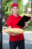 Courier bringing a package royalty free stock photos