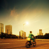 Courier. The courier in Chinese Shenzhen at dusk Royalty Free Stock Image