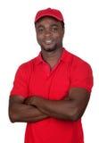 Courier d'ouvrier avec l'uniforme rouge photos stock